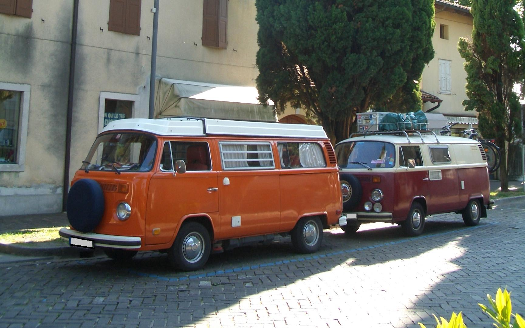 an orange Westfalia camper
